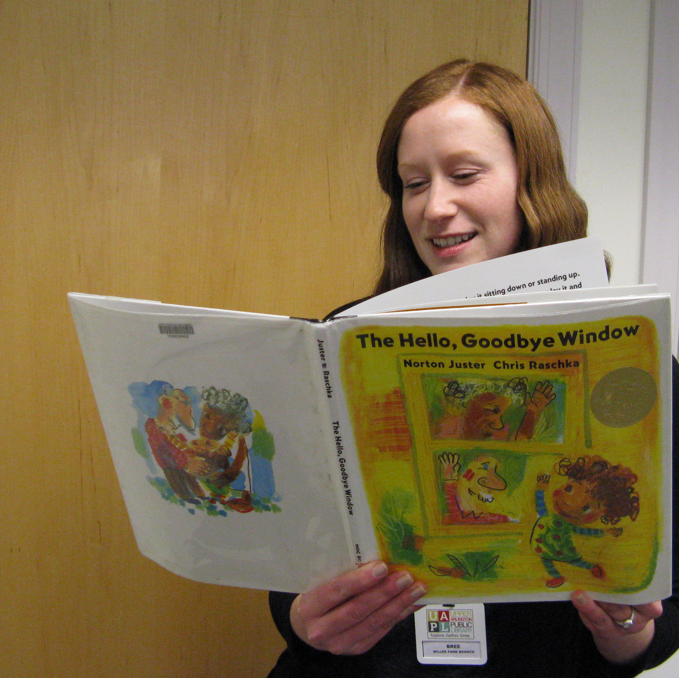 Photo of Bree reading the book The Hello, Goodbye Window