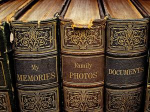 "Old books with spines labeled ""my memories,"" ""family photos,"" and ""documents."""