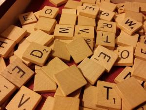 Mixed up letter tiles from a Scrabble game