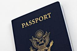 Photo of US Passport, navy blue with gold lettering and insignia