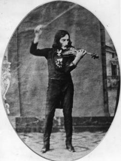Grainy black and white image of Italian violinist Niccolo Paganini performing