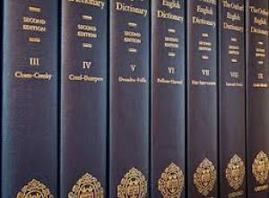 Volumes III through IX of the Oxford English Dictionary; dark blue bindings with gold lettering