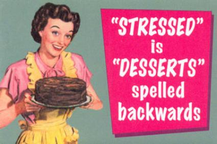 "Woman wearing apron offering large chocolate cake on tray ""Stressed is Desserts spelled backwards"""