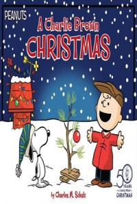 Charlie Brown and Snoopy standing text to a small Christmas tree