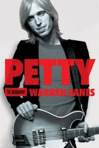 tom petty standing with a guitar
