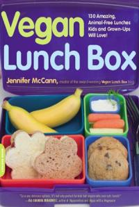 Child's lunch books containing sandwishes, carrots, bananas and cookies