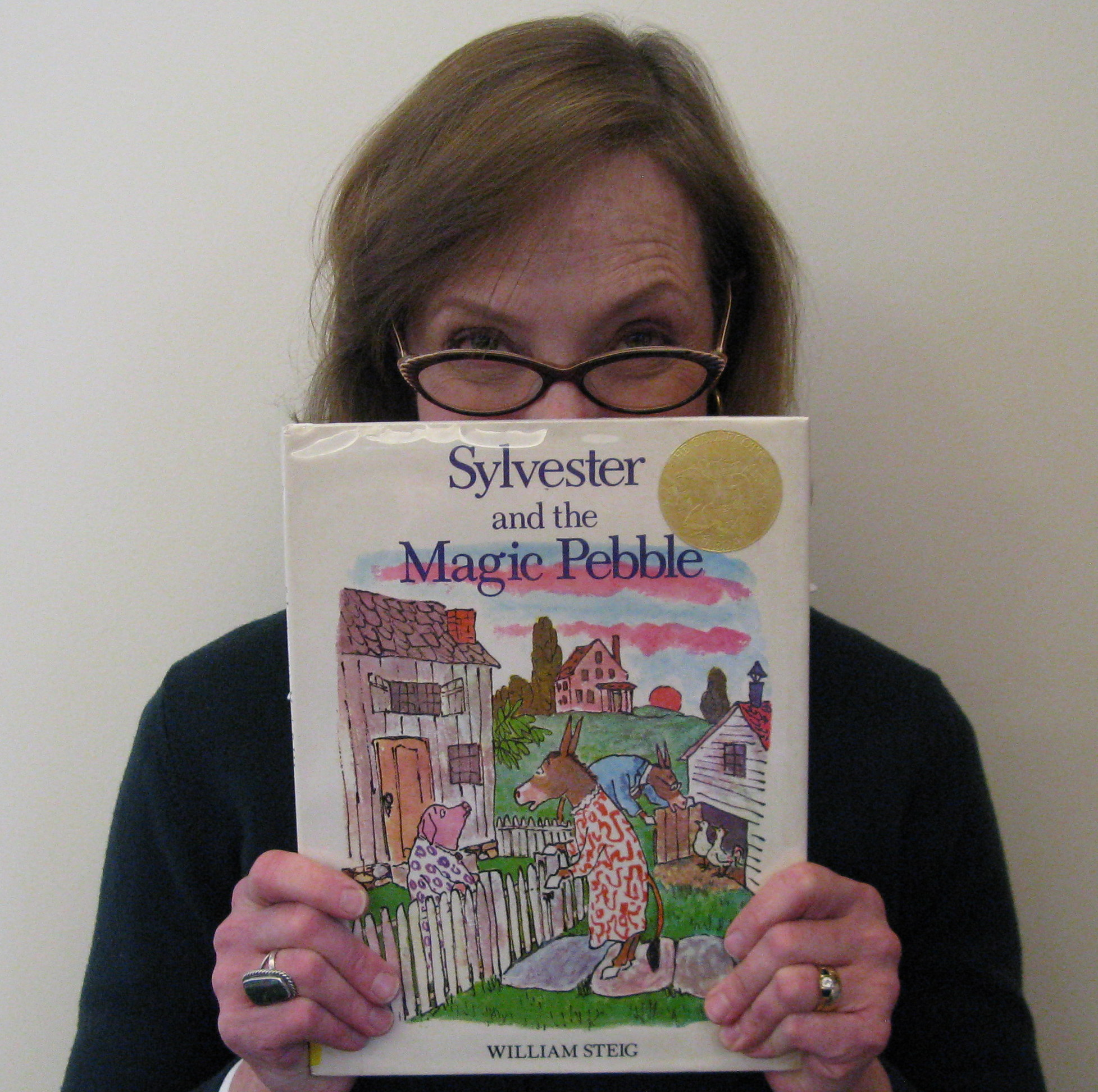 Photo of Julie holding the book Sylvester and the Magic Pebble