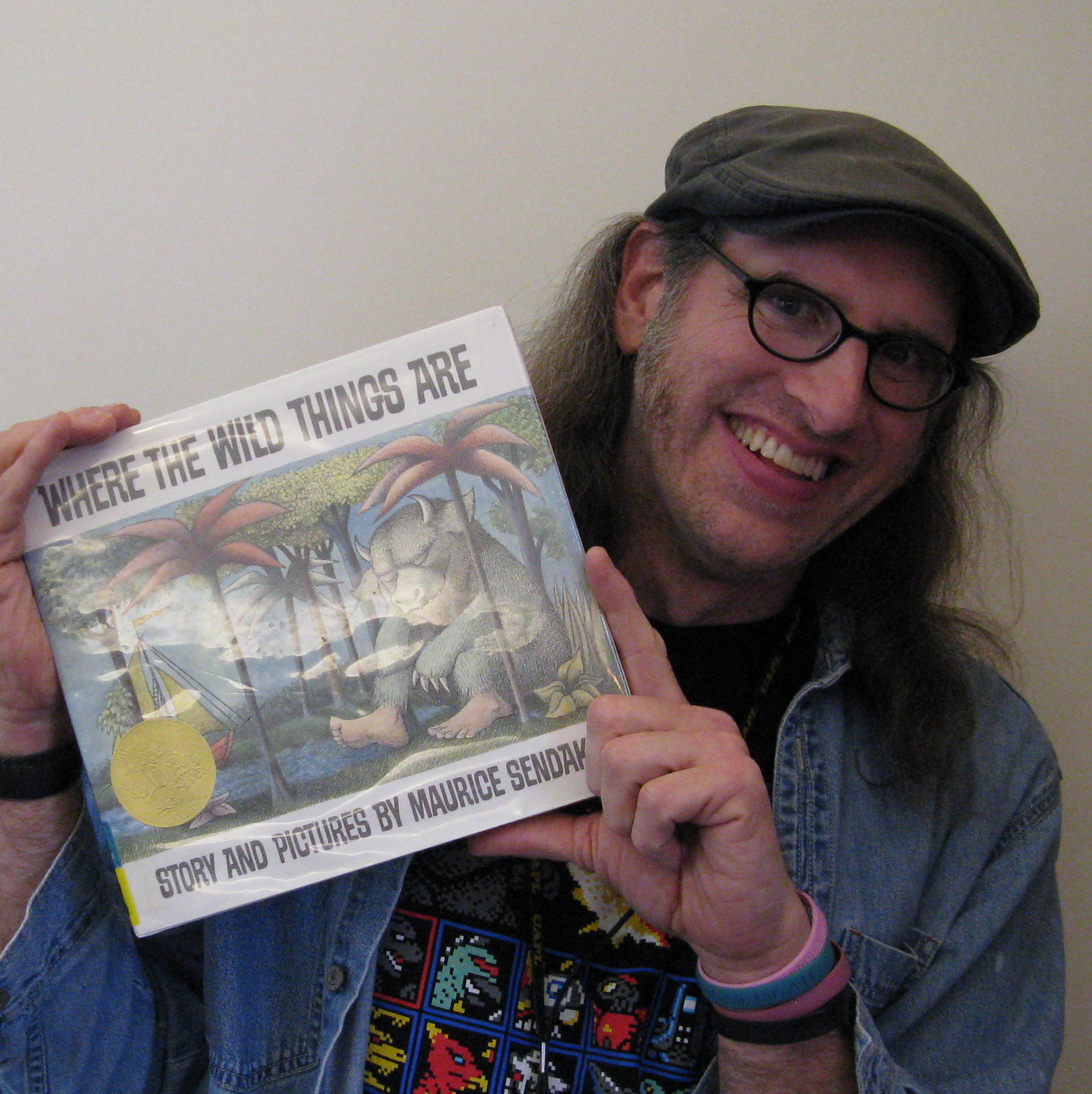 Photo of Brian holding the book Where the Wild Things Are