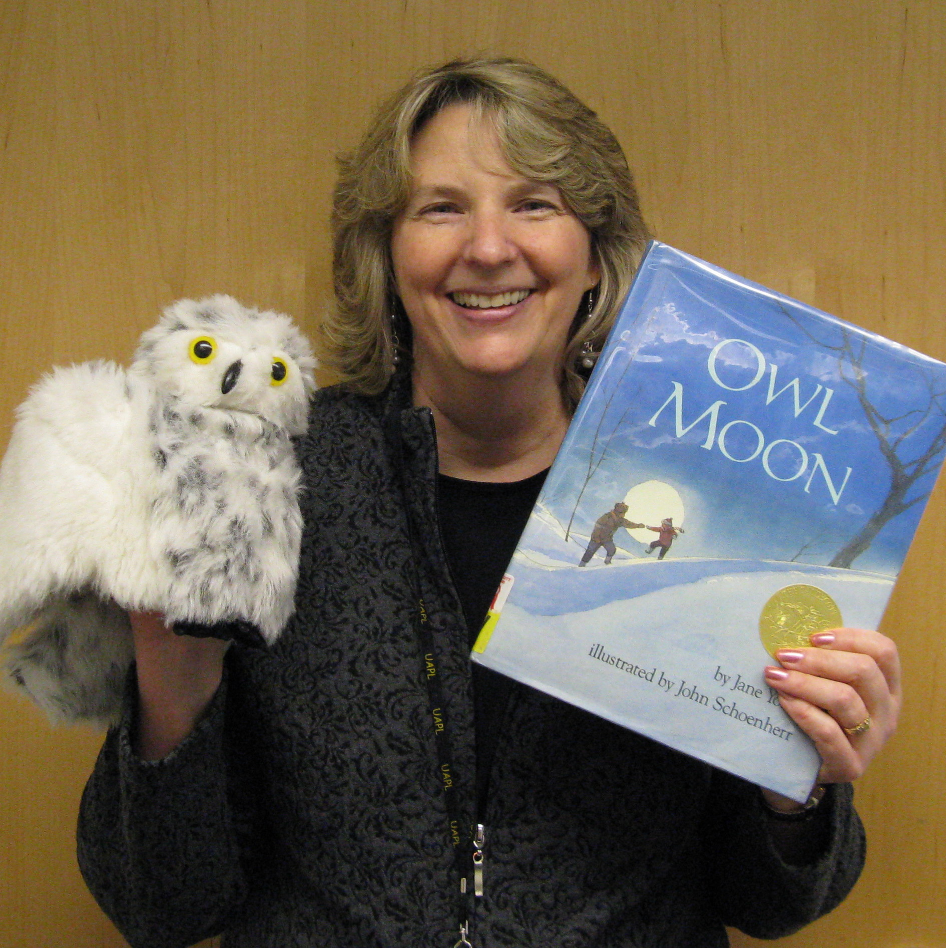 Photo of Kris holding the book Owl Moon and an owl puppet