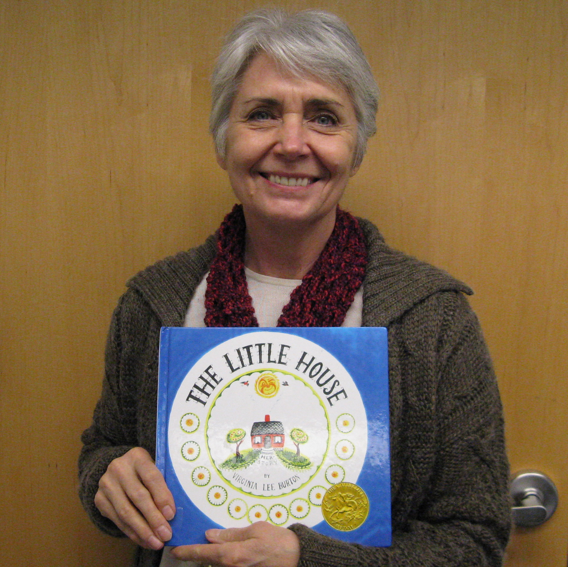 Photo of Alina holding the book The Little House